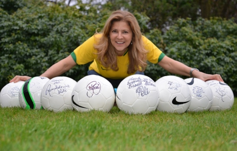Betise with the signed balls in front of her